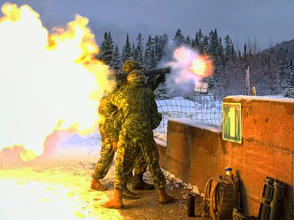 Canadian soldiers firing anti-tank weapons, rockets