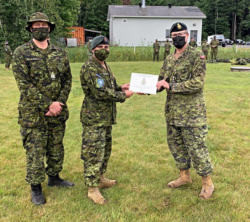 Master-Corporal Ali Khamehseifi receiving an award